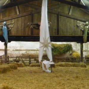 The crib in the nativity barn with all the animals