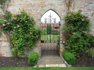 The gateway to the walled garden with fragrant roses surrounding it