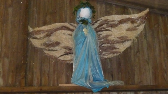 An angel in the nativity scenes in the barn at Christmas