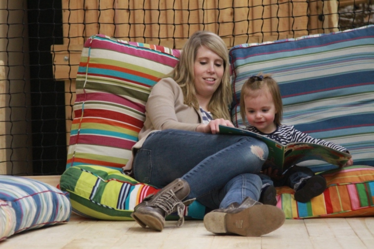 Story time on the comfy cushions in the under 5's play area