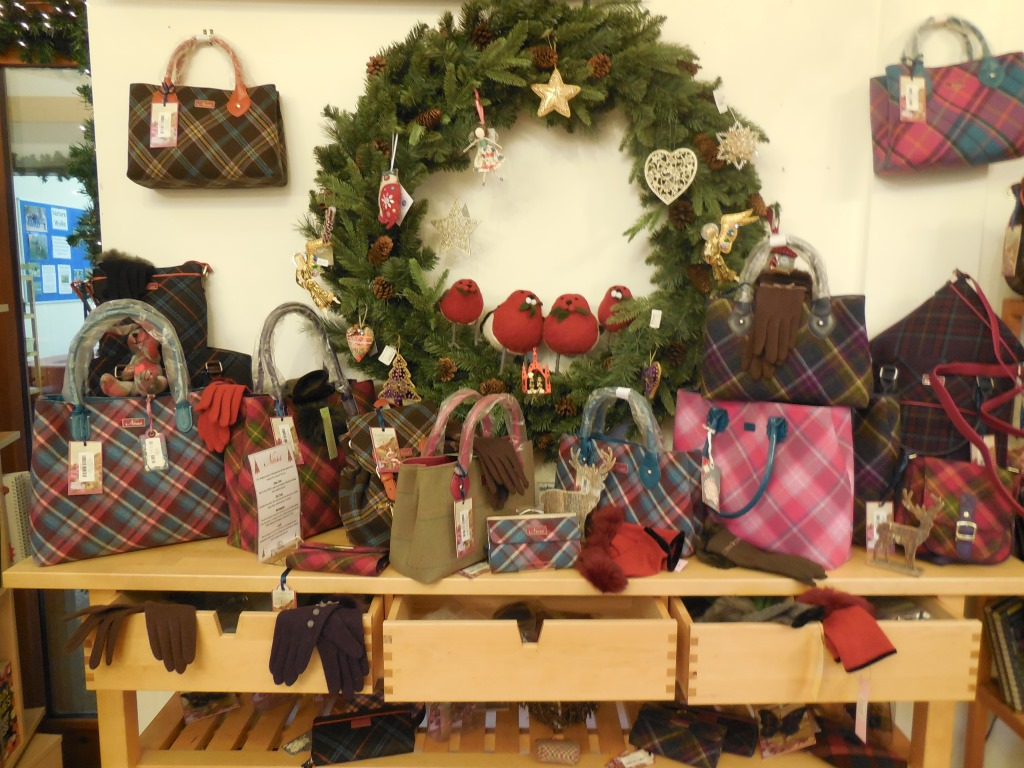 A selection of handbags and gloves