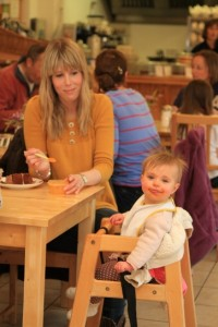 A little girl enjoying her lunch at Church Farm